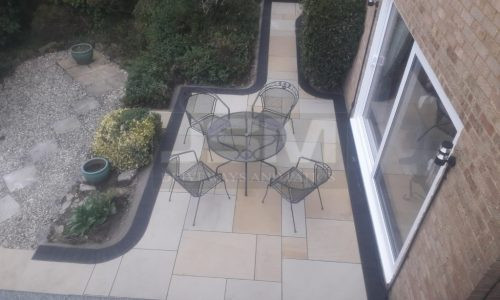 New Patio Installation With Indian Sandstone in Northampton